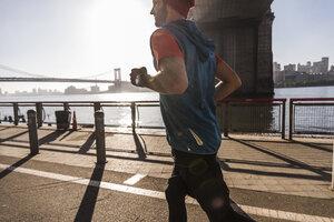 USA, New York City, man running at East River - UUF08813