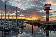 Germany, Eckernfoerde, marina and lighthouse at sunrise - KEBF00413