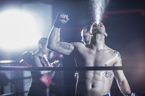 Boxer celebrating after win in boxing ring - ZEF11086