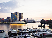 Germany, Dusseldorf, media harbor with marina at evening twilight - KRPF01905
