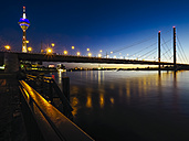 Germany, Duesseldorf, view to lighted Rheinknie-Bruecke and television tower by night - KRPF01914