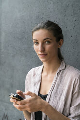 Portrait of young woman text messaging - TAMF00736