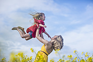 Mother and little daughter having fun together in rape field - ZEF11126