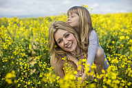 Mother and little daughter together in rape field - ZEF11129