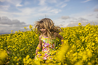 Blond little girl running in rape field - ZEF11132