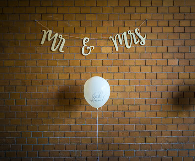 Wall decoration at a wedding, balloon against brick wall - MPAF00065