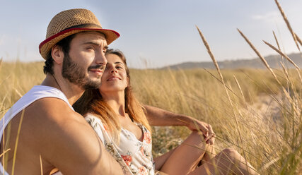 Couple in love sitting on a meadow - MGOF02580