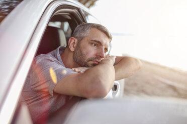 Man sitting in car, taking a break - SHKF00702
