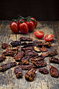 Dried tomatoes and fresh tomatoes on wood - LVF05539