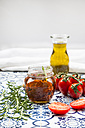 Glass of pickled dried tomatoes and ingredients - LVF05545