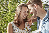 Happy couple in love on balcony - FMKF03148