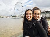 UK, London, portrait of two young women head to head in front of London Eye - AM05054