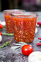 Glasses of homemade tomato sauce and ingredients on stone - SARF03039
