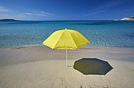 Italy, Sardinia, yellow sunshade on the beach at Rena Majori - MRF01658