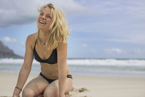Happy young woman on the beach - ZEF11320