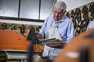 Shoemaker working in workshop - ZEF11329