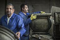 Two men working in industrial pot factory - ZEF11359