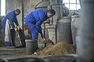 Two men working in industrial pot factory - ZEF11374