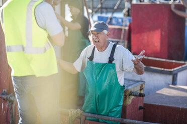 Fisherman on trawler talking to inspector - ZEF11404