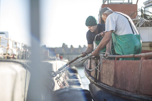 Fishermen working on trawler - ZEF11407