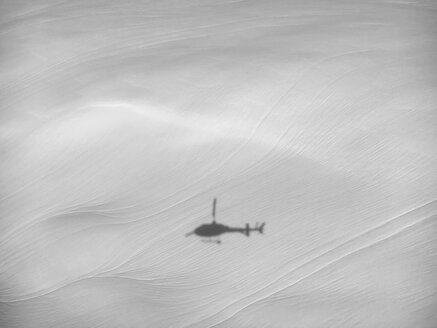 Switherland, Shadow of helicopter over snow - BMAF00271