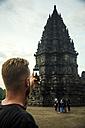 Indonesia, Java, Tourist photographing Prambanan temple - KNTF00575