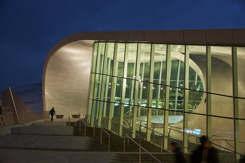 Netherlands, Arnheim, lighted glass facade of central station by night - BSC00552