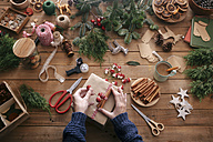 Woman's hands decorating Christmas present - RTBF00494