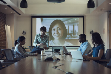 Business people having a video conference in board room - WESTF21903