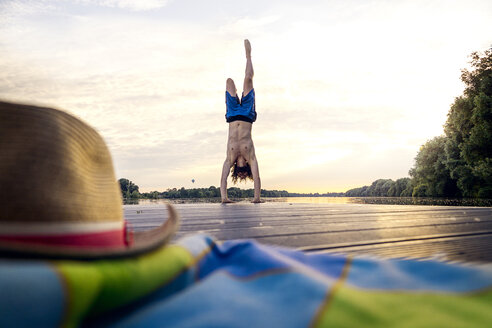Man doing a handstand on jetty - BMAF00281