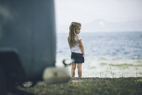 Italy, Lake Garda, girl standing at lakeshore - SBOF00257