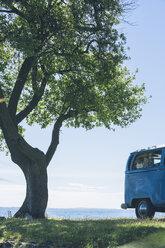 Italy, Lake Garda, camping bus at lakeshore - SBOF00284