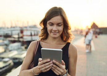 Germany, Hamburg, Young woman using digital tablet - WHF00009
