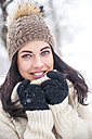 Portrait of smiling woman wearing knitwear in winter - HHF05474