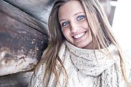 Portrait of smiling blond woman wearing knitwear in winter - HHF05477
