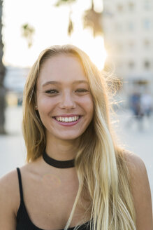 Portrait of happy young woman outdoors - KKAF00019
