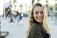 Portrait of happy young woman outdoors - KKAF00025