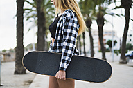 Spain, young woman with skateboard - KKAF00042