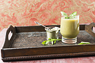 Glass of green smoothie and green tea powder - MYF01825