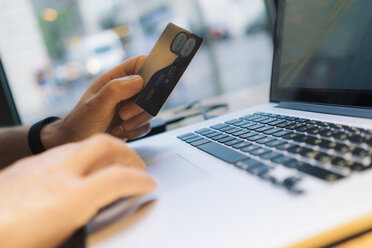 Online shopping with credit card and laptop - GIOF01593