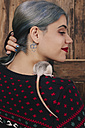 Young woman with pet rat on her shoulder wearing patterned knit pullover - RTBF00521