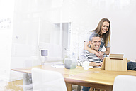 Happy couple at home using tablet - MADF01178
