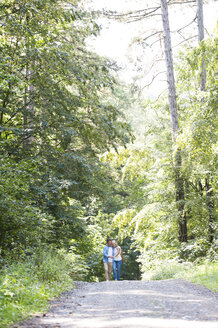 Happy senior couple walking in the woods - HAPF01060