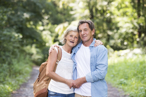 Portrait of happy senior couple relaxing together in the woods - HAPF01063