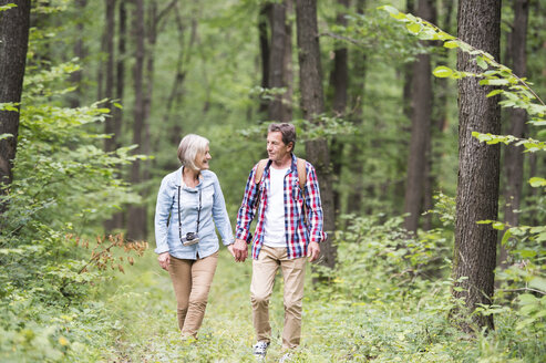 Senior couple walking in the woods - HAPF01078