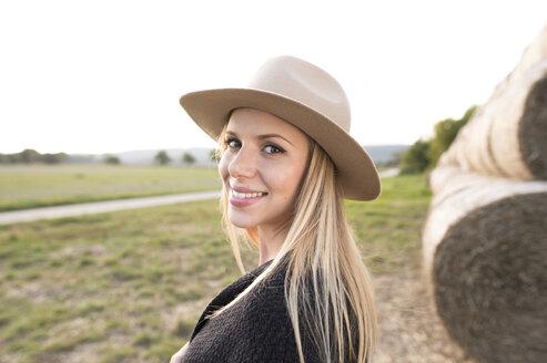 Smiling woman in rural landscape - HAPF01094