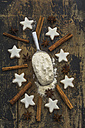 Shovel of flour, cinnamon stars, star anise and cinnamon sticks - ODF01459