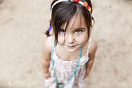 Portrait of little girl looking up to camera - VABF00819