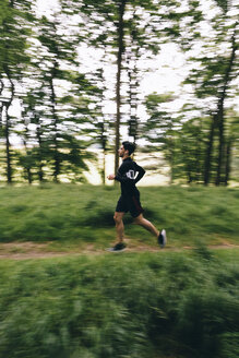 Man running on forest track - BOYF00633