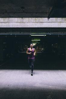 Man running in car park - BOYF00666